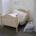 Das gestauchte Holzbett